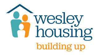wesley housing logo with the tagline 'building up'